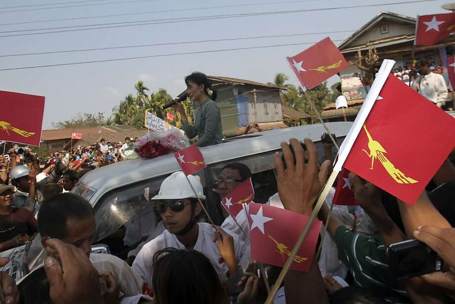 Myanmar pro-democracy leader Aung San Suu Kyi delivers her speech to supporters from her car as she arrives Sunday, Jan.2 9, 2012, in Dawei, about 615 km (380 miles) south of Yangon, Myanmar. Thousands of supporters in Myanmar's countryside cheered opposition leader Aung San Suu Kyi  during her first campaign tour for parliament Sunday, highlighting how quickly and dramatically politics is changing in this long-repressed Southeast Asian nation. (AP Photo/Khin Maung Win) Photo: Khin Maung Win, Associated Press