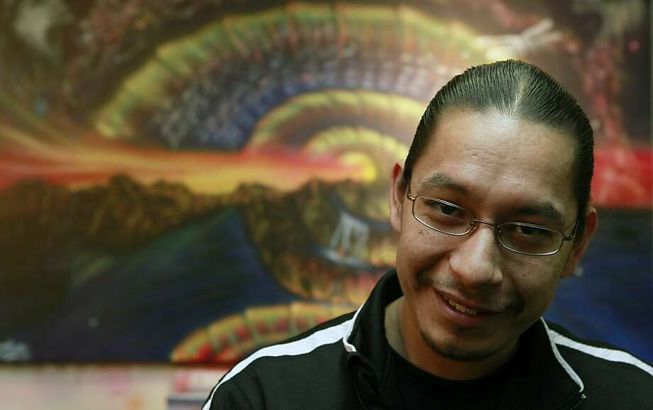 Chief Leonard Alden Crow Dog Jr from the Lakota tribe of North Dakota stands in front of one of his commissioned paintings in his Oakland, Calif., studio Wednesday, January 25, 2012. Photo: Lance Iversen, The Chronicle