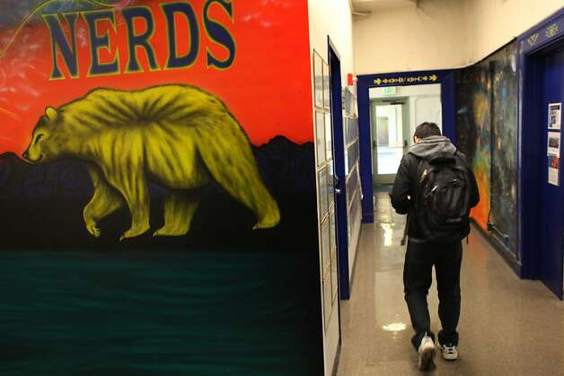 Students walk through the hallway where murals created by Leonard Crow Dog, son of the Chief of the Lakota Sicangu Indians in South Dakota, are displayed, Tuesday January 17, 2012, in Stephens Hall at UC Berkeley in Berkeley, Calif. Photo: Lacy Atkins, The Chronicle