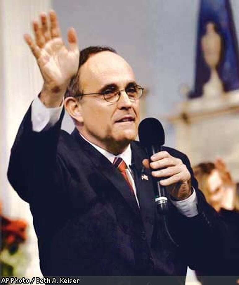 New York City Mayor Rudolph Giuliani waves his hand as he delivers his farwell speech to members of his staff and invited guests Thursday, Dec. 27, 2001, at St. Paul Chapel in New York. one block east of ground zero. Giuliani said goodbye Thursday to the city where he battled crime, his critics and the Sept. 11 crisis during eight years in City Hall. (AP Photo / Beth A. Keiser) Photo: BETH A. KEISER