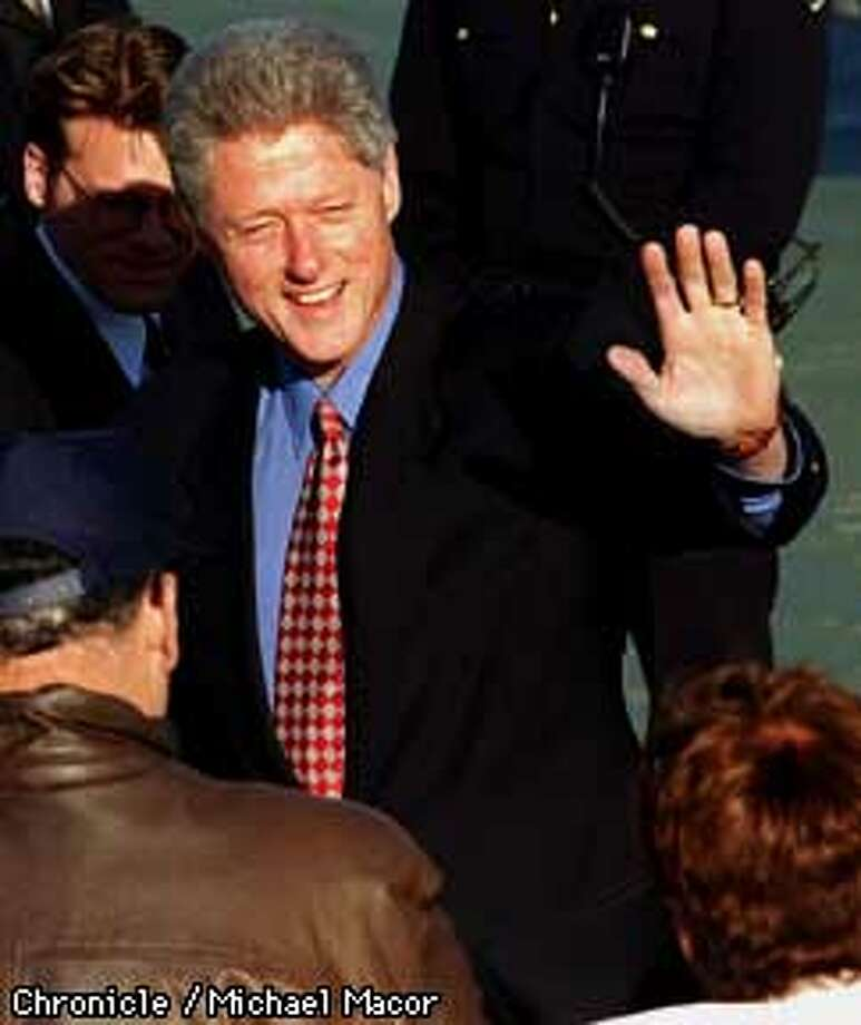 President Bill Clinton arrives at San Francisco International airport Sunday afternoon. Clinton waves to a small crowd before departing to downtown San Francisco. Chronicle Photo: Michael Macor Photo: MICHAEL MACOR