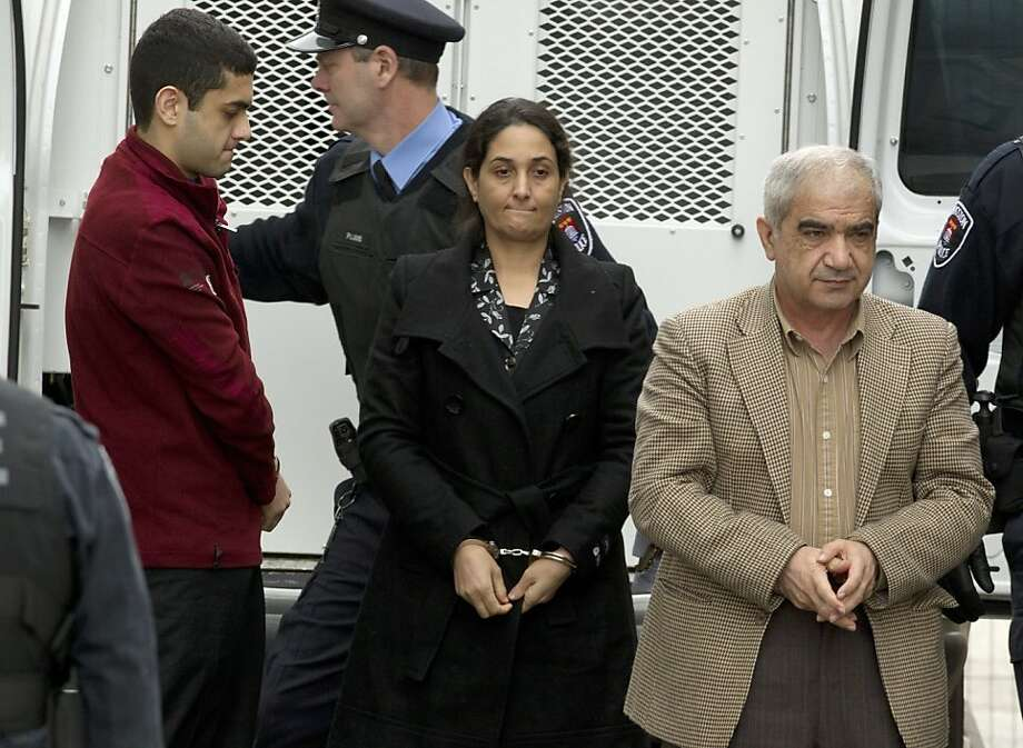Mohammad Shafia, right, Tooba Yahya, center, and their son Hamed Mohammed Shafia, left, are escorted into the Frontenac County courthouse in Kingston, Ontario, Canada on Thursday, Jan. 26, 2012. The prosecution accuses Afghan-born Shafia, his wife, and their 20-year-old son of killing the daughters because they dishonored the family by defying its disciplinarian rules on dress, dating, socializing and going online. The older victim was Shafia's first wife, Rona Amir Mohammad, who was living with him and his second wife, Tooba Mohammad Yahya, 41, in Montreal. It was a polygamous relationship, the court has been told, and if revealed, could have resulted in their deportation. (AP Photo/The Canadian Press, Frank Gunn) Photo: Frank Gunn, Associated Press