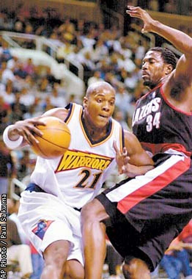 Golden State Warriors forward Danny Fortson dribbles in front of Portland Trail Blazers forward Dale Davis in the second quarter of an exhibition game Friday, Oct. 13, 2000, at the San Jose Arena in San Jose, Calif. (AP Photo/Paul Sakuma) Photo: PAUL SAKUMA