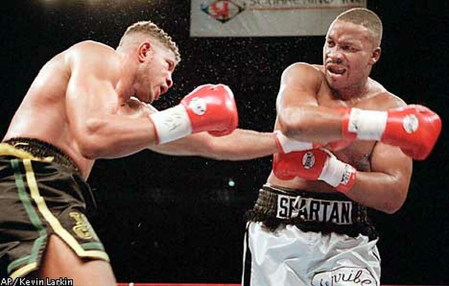 IBF cruiserweight champion Alfred Cole, left, of Spring Valley, N.Y., tries to land one on former two-time heavyweight champion Tim Witherspoon of Philadelphia in the fourth round of their heavyweight bout in New York's Madison Square Garden Friday, Jan. 12, 1996. Witherspoon won the bout by decision. (AP Photo/Kevin Larkin)