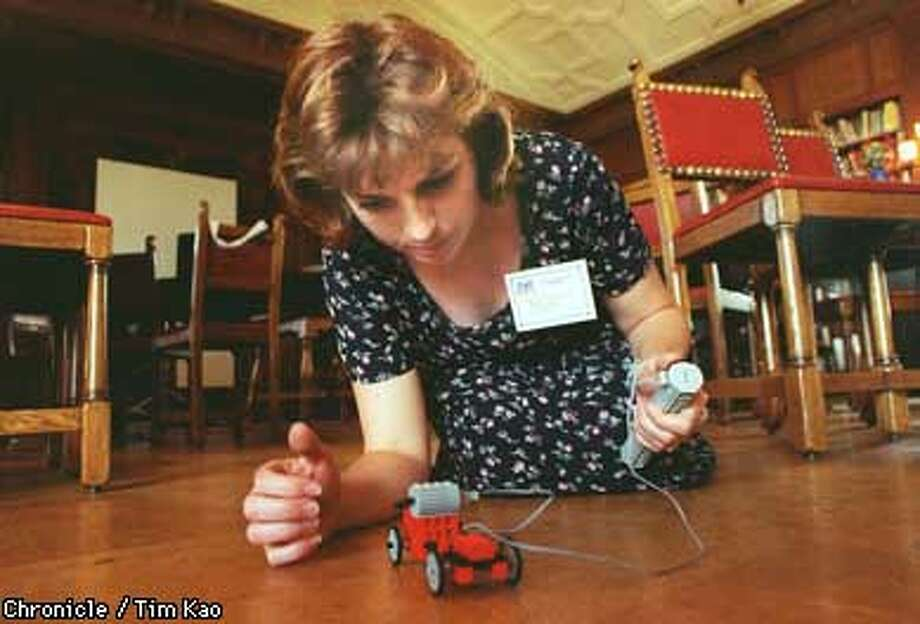 =Kate Sheehan Roach road-tests the motorized Lego car she had just built. Roach, a high school history teacher from the private Webb Schools in Claremont, CA, learned the intricacies of Lego as part of a conference on how to get school-aged girls interested in technology. After several tries that included a crash off the table top, Roach got the cart moving. photo by Tim kao/the chronicle Photo: TIM KAO