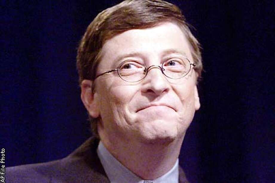 """Corp. Chairman Bill Gates, responds to a Federal District Court ruling during a news conference at the campus in Redmond, Wash., Friday, Nov. 5, 1999. A federal judge declared Corp. a monopoly Friday, ruling that aggressive actions by Gates' software empire to protect its technology dominance are """"stifling innovation"""" and hurting consumers. (AP Photo/The Seattle Times, Barry Wong) Photo: BARRY WONG"""