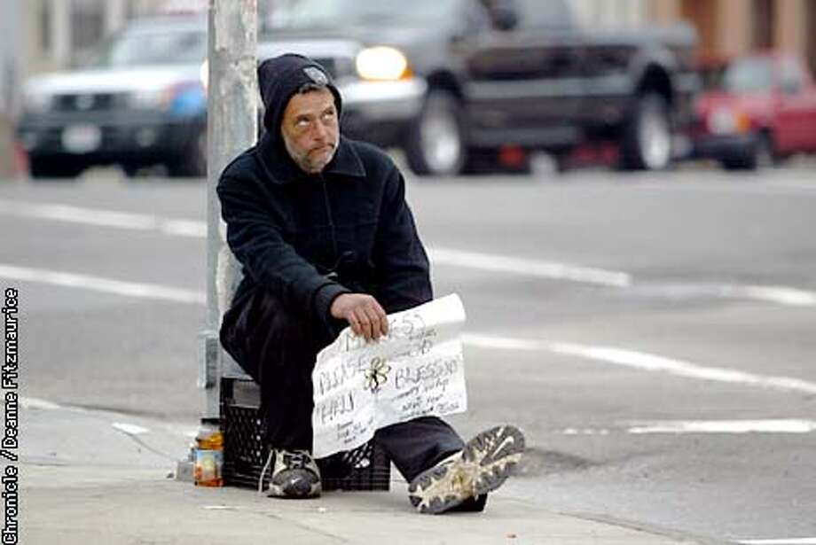 Chris Sears, 40, homeless in San Francisco, panhandles at the 5th Street and Harrison intersection. Supervisor Gavin Newsom is proposing a bill to outlaw panhandling in such places.  CHRONICLE PHOTO BY DEANNE FITZMAURICE Photo: DEANNE FITZMAURICE