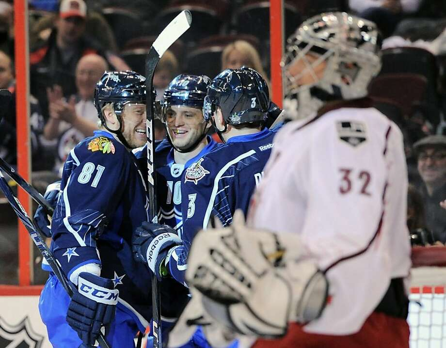 Team Chara's Marian Gaborik, center, is congratulated following his third goal past Team Alfredsson goaltender Jonathan Quick (32) by teammates Marain Hossa, left, and Dion Phaneuf during the second period of the NHL All-Star hockey game on Sunday, Jan. 29, 2012, in Ottawa, Ontario. (AP Photo/The Canadian Press, Sean Kilpatrick) Photo: Sean Kilpatrick, Associated Press