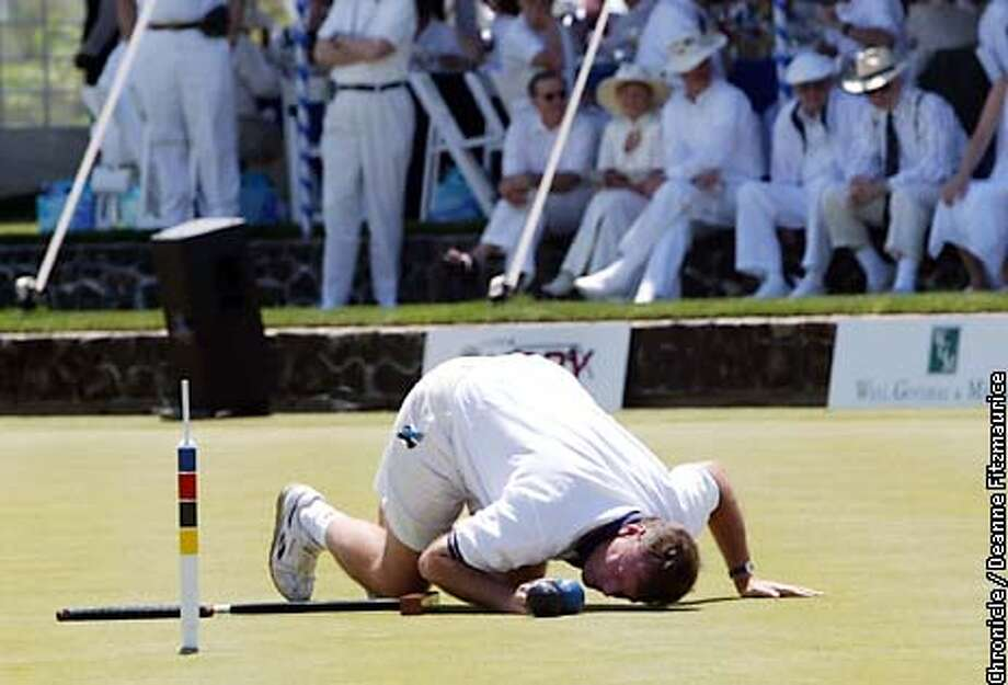 """World Champion Croquet player Reg Bamford from South Africa lines up to """"peg out"""" to win the match and keep the title at Sonoma-Cutrer Vineyards for the Croquet World Championship in Windsor.  CHRONICLE PHOTO BY DEANNE FITZMAURICE Photo: DEANNE FITZMAURICE"""