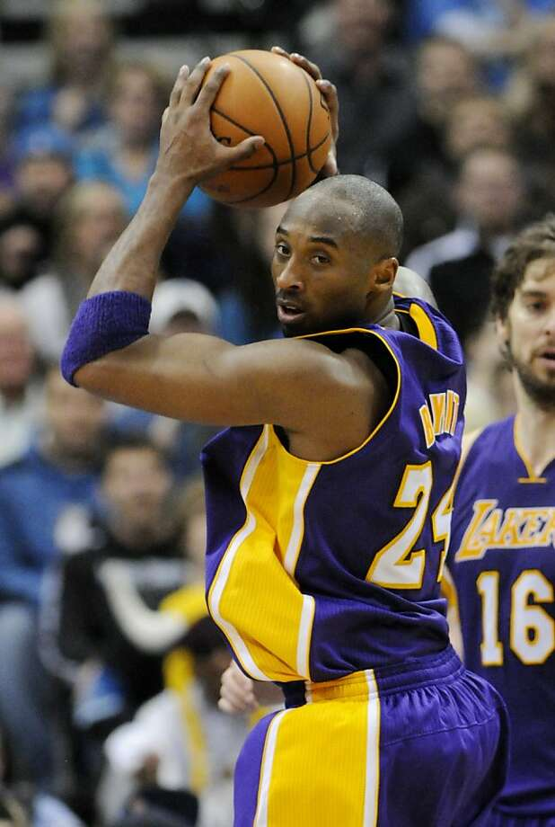 Los Angeles Lakers' Kobe Bryant pulls in one of his 14 rebounds, in the second half of an NBA basketball game against the Minnesota Timberwolves on Sunday, Jan. 29, 2012, in Minneapolis. The Lakers won 106-101. (AP Photo/Jim Mone) Photo: Jim Mone, Associated Press
