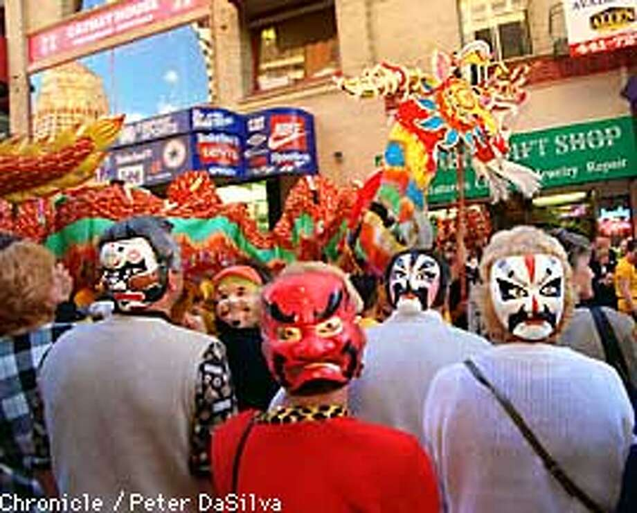 Mayor Mik Traficante of Cranston, R.I. (center, under dragon) and his administrators wore their masks backwards in Chinatown.