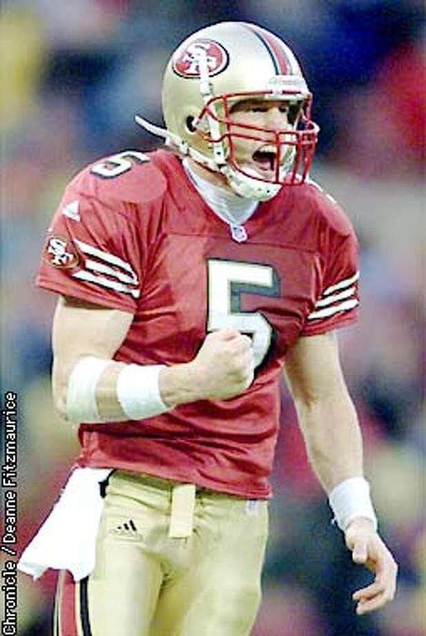Jeff Garcia celebrates in the final moments of the game when it became clear that the 49ers had sewn up the victory. The San Francisco 49ers take on the New Orleans Saints on Sunday, November 11, 2001 at 3Com. Deanne Fitzmaurice/The Chronicle Photo: Deanne Fitzmaurice