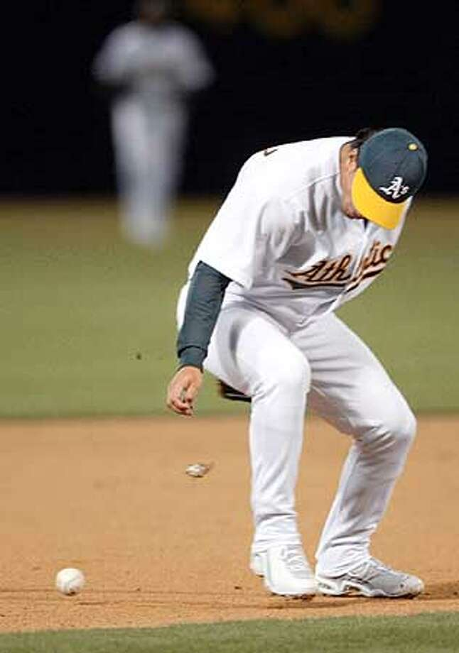 Gold Glove winner Eric Chavez epitomized the A's woes as he booted a grounder. Chronicle photo by Jeff Chiu