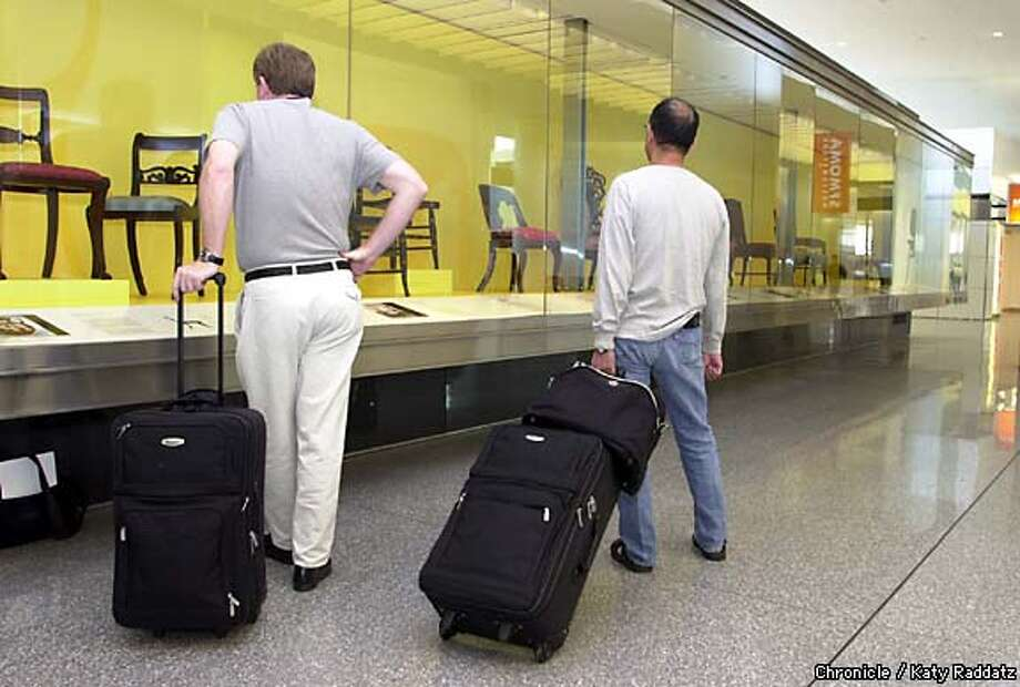 Checking out the exhibition of chairs at the San Francisco International Airport's international terminal are Dallas-bound passengers Steve Quiroz, left, and Cash Keahey. Chronicle photo by Katy Raddatz