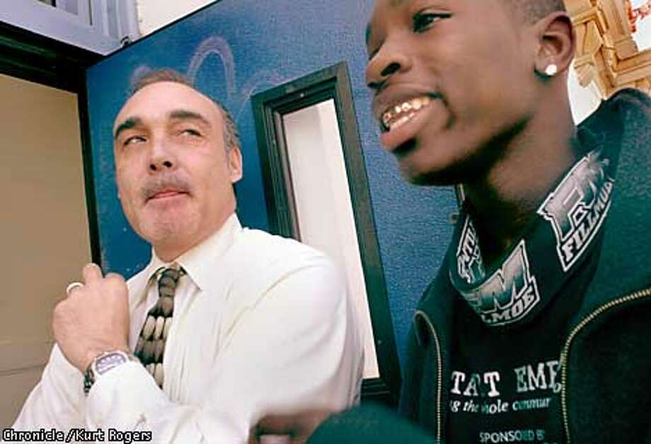 Mission High School Principal Kevin Truitt (left) bumped into Raymon Bass while making the rounds at the San Francisco school. Chronicle photo by Kurt Rogers
