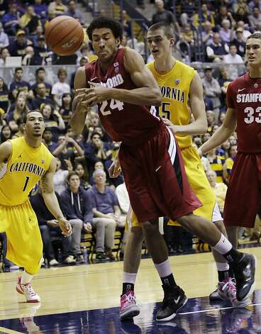 Stanford forward Josh Huestis (24) loses the ball against California forward Bak Bak (15) in the second half of an NCAA college basketball game in Berkeley, Calif., Sunday, Jan. 29, 2012. California defeated Stanford 69-59.  (AP Photo/Paul Sakuma) Photo: Paul Sakuma, Associated Press