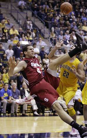 Stanford center Stefan Nastic (4) falls over in front of California forward Harper Kamp (22) in the first half of an NCAA college basketball game in Berkeley, Calif., Sunday, Jan. 29, 2012. (AP Photo/Paul Sakuma) Photo: Paul Sakuma, Associated Press