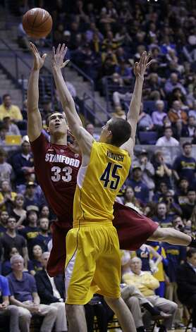 Stanford forward Dwight Powell (33) shoots in front of California forward David Kravish (45) in the first half of an NCAA college basketball game in Berkeley, Calif., Sunday, Jan. 29, 2012. (AP Photo/Paul Sakuma) Photo: Paul Sakuma, Associated Press