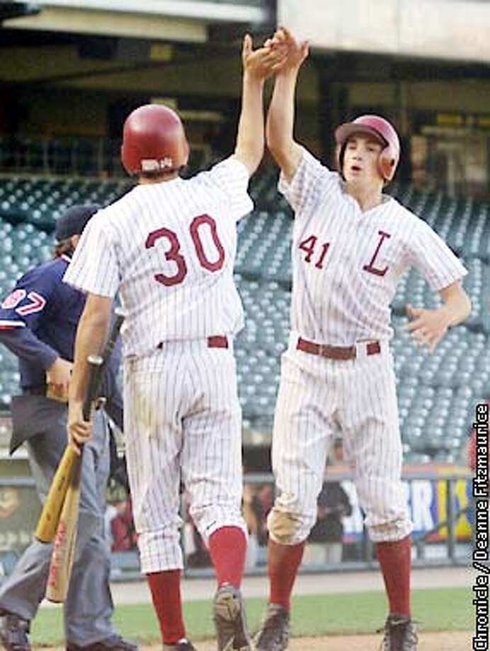 Charlie Cutler (41) is congratulated by Jacob Cutler (30) after Charlie scores the first run for Lowell HS against Washington HS. AAA San Francisco HS Baseball Championship at Pacific Bell Park. CHRONICLE PHOTO BY DEANNE FITZMAURICE Photo: DEANNE FITZMAURICE