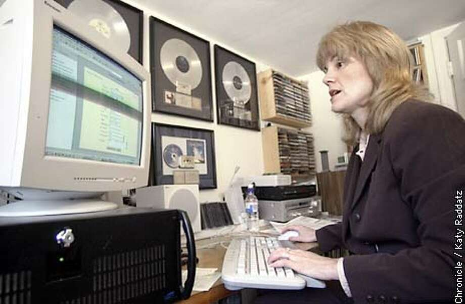 PHOTO BY KATY RADDATZ--THE CHRONICLE  Val Starr runs an online radio business called Choice Radio. She is shown encoding and programming music on the web, and says if it weren't for small stations like hers, most musicians would NEVER be heard. She earned the gold and platinum records on the wall when she was in promotions. Photo: KATY RADDATZ