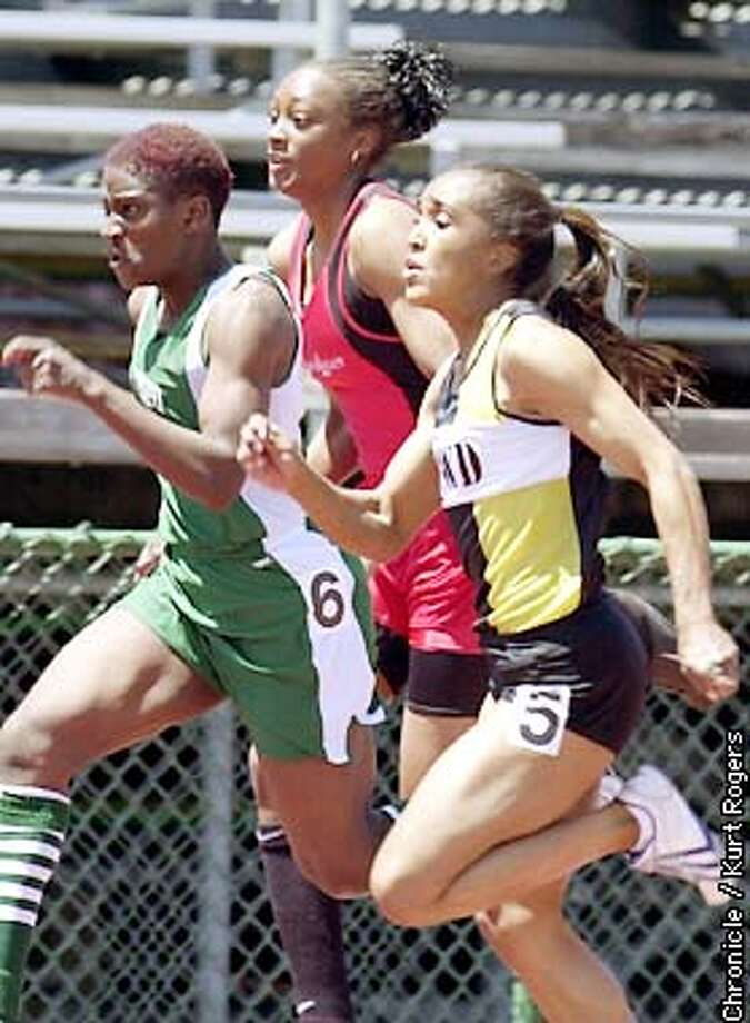 Cheri in thein the center was falling behind in the 100 dash because of a pulled ham string . Sister-brother act of Cheri Craddock and Kevin Craddock, both of James Logan High, are two of the state's top track and field athletes.Photo By Kurt Rogers Photo: Kurt Rogers