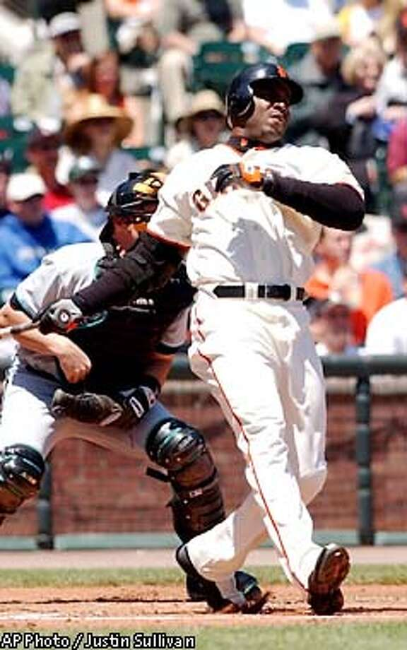 San Francisco Giants' Barry Bonds watches his two-run home run off Florida Marlins starting pitcher Brad Penny during the first inning Saturday, May 18, 2002, in San Francisco. (AP Photo/Justin Sullivan) Photo: JUSTIN SULLIVAN