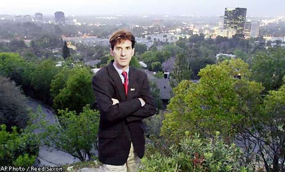 ** ADVANCE FOR SUNDAY MAY 19 ** Jeff Brain, the leader of Valley Vote, the organization pushing for the secession of the San Fernando Valley from the city of Los Angeles, poses for a twilight portrait above what is currently the Sherman Oaks district of Los Angeles, Wednesday, May 15, 2002. No one thought it could get this far, but after years of trying, secession forces are likely to force a vote that could separate Hollywood, the San Fernando Valley and the port area of San Pedro from Los Angeles. A goverment committee will decide May 22 whether to put the secession proposals on the ballot. (AP Photo/Reed Saxon) Photo: REED SAXON