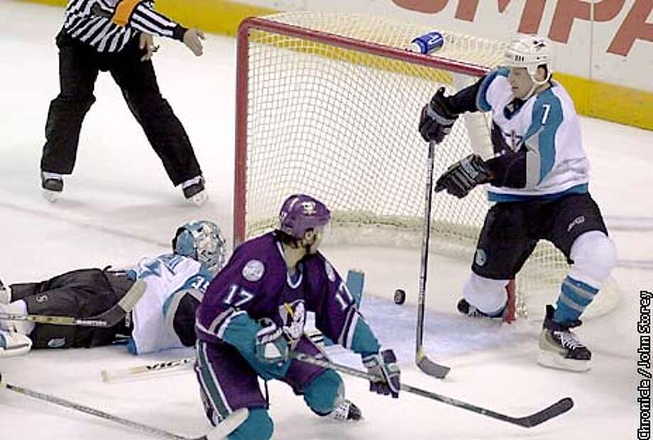 SHARKS-C-26DEC01-SP-JRS-The Sharks vs. the Ducks at the San Jose Arena. Shark's goalie Evgeni Nabokov and Brad Stuart (7) watch Mike Leclerc's goal in the 1srt period. (17) is Matt Cullen of the Ducks whon didn't score the goal. Chronicle Photo by John Storey. Photo: John Storey