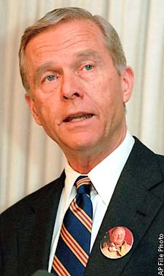 FILE--California Gov. is seen in this Oct. 29, 1996, file photo. Chief U.S. District Judge Thelton Henderson issued a temporary restraining order Wednesday, Nov. 27, 1996, barring Wilson and Attorney General Dan Lungren from taking any action to enforce Proposition 209, at least until a Dec. 16 hearing. (AP Photo/Chris Pizzello) ALSO RAN: 01/05/1999, 07/21/2001 Photo: CHRIS PIZZELLO