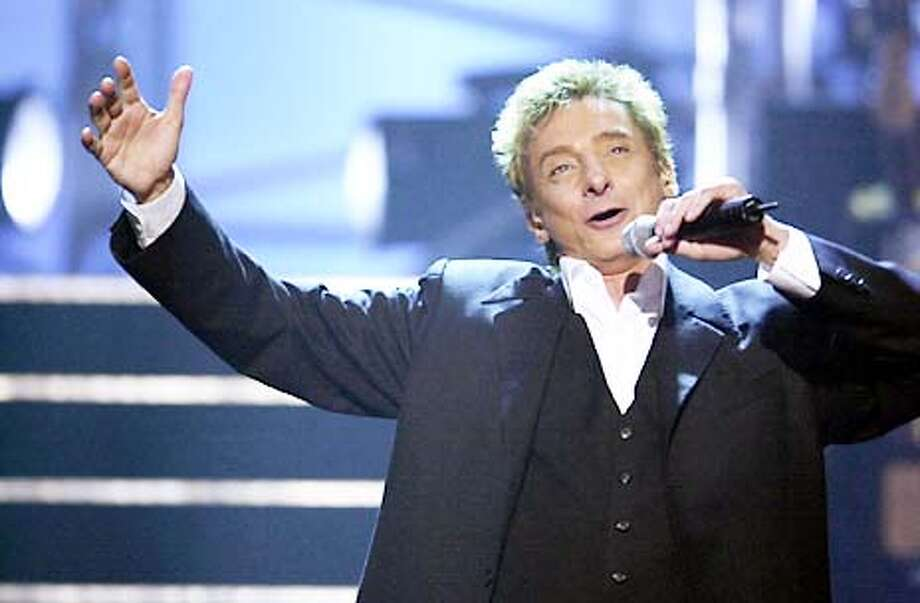 """caption: Music superstar Barry Manilow will perform his greatest hits and more on ULTIMATE MANILOW!, a new concert-style entertainment special, taped at the Kodak Theater in Hollywood, to be broadcast Saturday, May 18 (9:00-10:00 PM, ET/PT) on the CBS Television Network. Manilow will perform some of his most beloved songs from his album Ultimate Manilow, including """"Ready To Take A Chance Again,"""" """"Daybreak,"""" """"Somewhere In The Night,"""" """"This One's For You,"""" """"Weekend In New England,"""" """"Can't Smile Without You"""" and """"Copacabana."""" He will also perform a medley on a piano bar-style set that will include """"Bandstand Boogie"""" and """"Mandy,"""" and he will sing """"They Dance"""" from his new album, Here At The Mayflower. copyright: Photo: Tony Esparza/CBS  �2002 CBS Worldwide Inc. All Rights Reserved  (HANDOUT PHOTO) Photo: HANDOUT"""