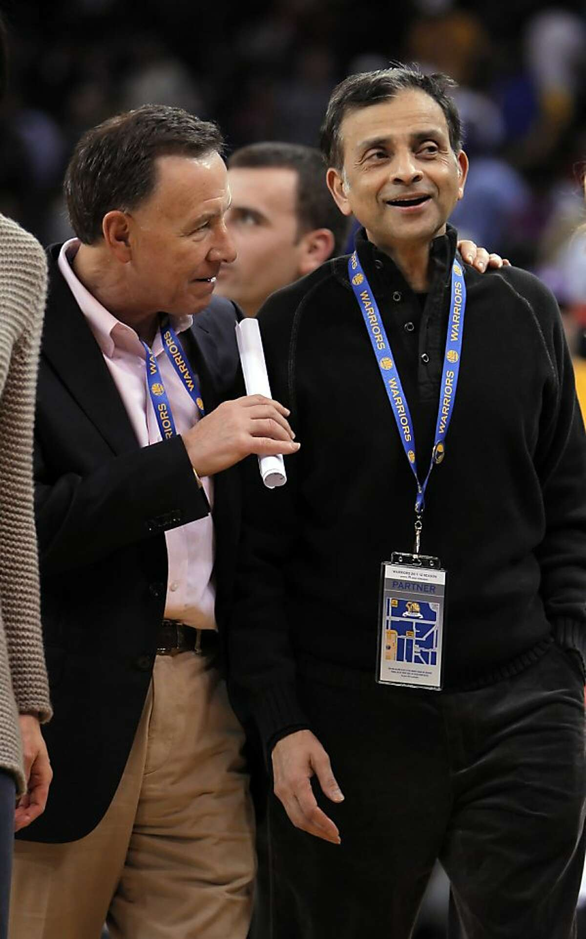 Vivek Ranadive, right, part owner of the Golden State Warriors, is CEO of Tibco Software, and the NBA's first Indian-American owner of a team. Here he speaks with Carl Pascarella, left, at halftime of the Warriors game against the Chicago Bulls on Monday, December 26, 2011 at Oracle Arena in Oakland, Calif.