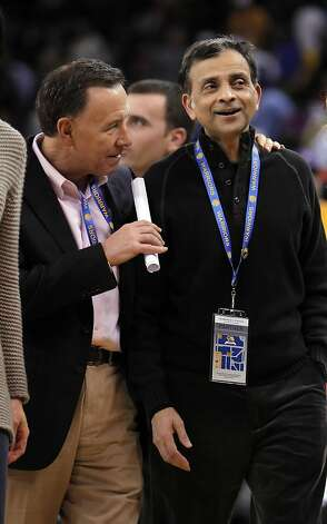 Vivek Ranadive, right, part owner of the Golden State Warriors, is CEO of Tibco Software, and the NBA's first Indian-American owner of a team. Here he speaks with Carl Pascarella, left, at halftime of the Warriors game against the Chicago Bulls on Monday, December 26, 2011 at Oracle Arena in Oakland, Calif. Photo: Carlos Avila Gonzalez, The Chronicle
