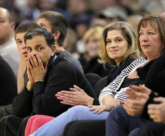 Vivek Ranadive, left, part owner of the Golden State Warriors, is CEO of Tibco Software, and the NBA's first Indian-American owner of a team. Here he attends the Warriors game against the Chicago Bulls on Monday, December 26, 2011 at Oracle Arena in Oakland, Calif. Photo: Carlos Avila Gonzalez, The Chronicle