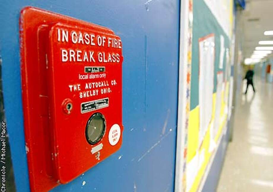 The fire pulls are the original ones installed in 1971. Enola Maxwell Midle School is one of 97 schools in San Francisco that was earmarked to receive funds approved by voters in 1990 to correct fire safety violations. by Michael Macor/The Chronicle Photo: MICHAEL MACOR