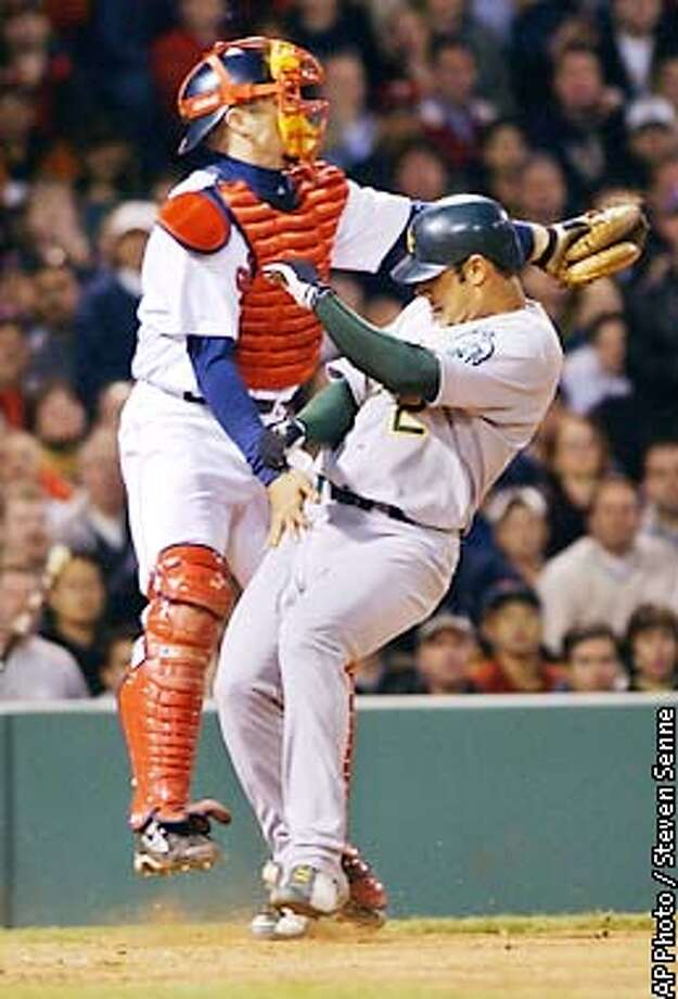 Oakland Athletics' Carlos Pena, right, collides with Boston Red Sox catcher Jason Varitek, left, as Pena scores on a single by Jeremy Giambi in the fifth inning at Boston's Fenway Park, Wednesday, May 15, 2002. (AP Photo/Steven Senne) Photo: STEVEN SENNE