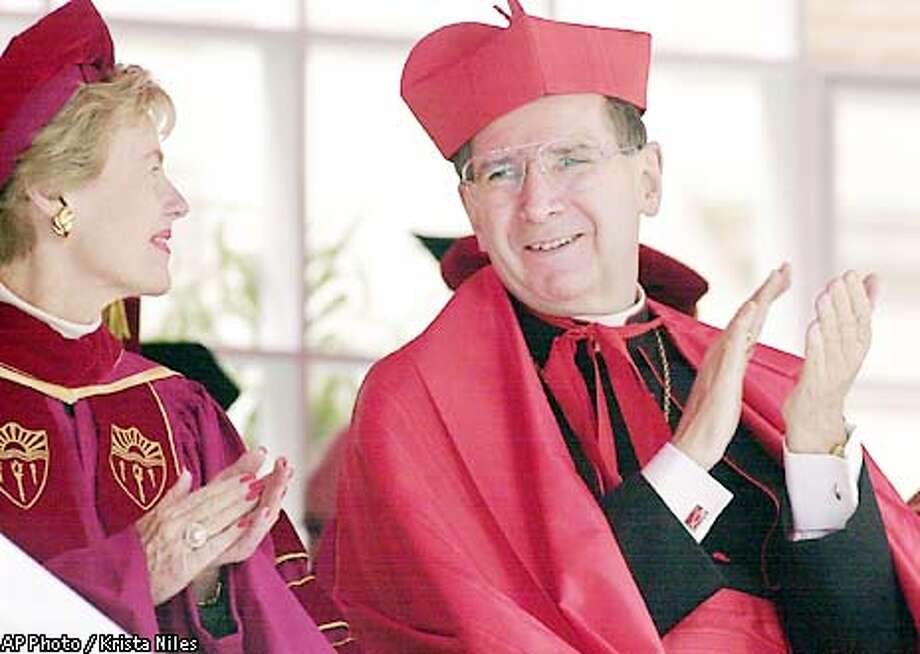 Cardinal Roger Mahony, right, and Kathleen L. McCarthy, vice chairman of the University of Southern California (USC) Board of Trustees applaud during USC's 119th Annual Commencement Ceremony, Friday, May 10, 2002, in Los Angeles. Cardinal Mahony, who leads the nation's largest Catholic Archdiocese, received an honorary doctorate, Doctor of Humane Letters. Mahony was selected for his record of leadership and service, according to USC President Steven B. Sample. (AP Photo/Krista Niles) Photo: KRISTA NILES