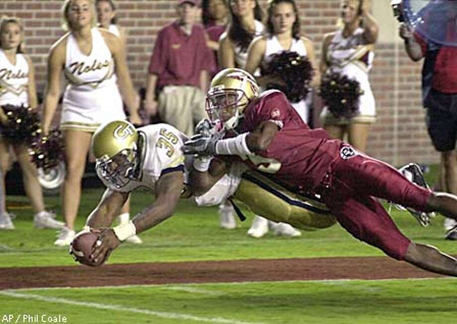 Joe Burns, who was kept out of the end zone at Florida State, has now been tackled by the NCAA because of his academic problems. Associated Press photo by Phil Coale