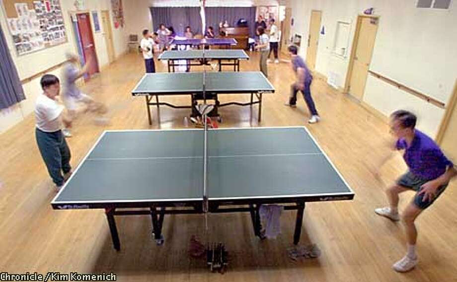 The Oakland Table Tennis Club plays several times a week at the Smith Recreation Center on Park Blvd. Overall: Advanced players in the foreground and they get worse as they get farther away.  CHRONICLE PHOTO BY KIM KOMENICH Photo: KIM KOMENICH