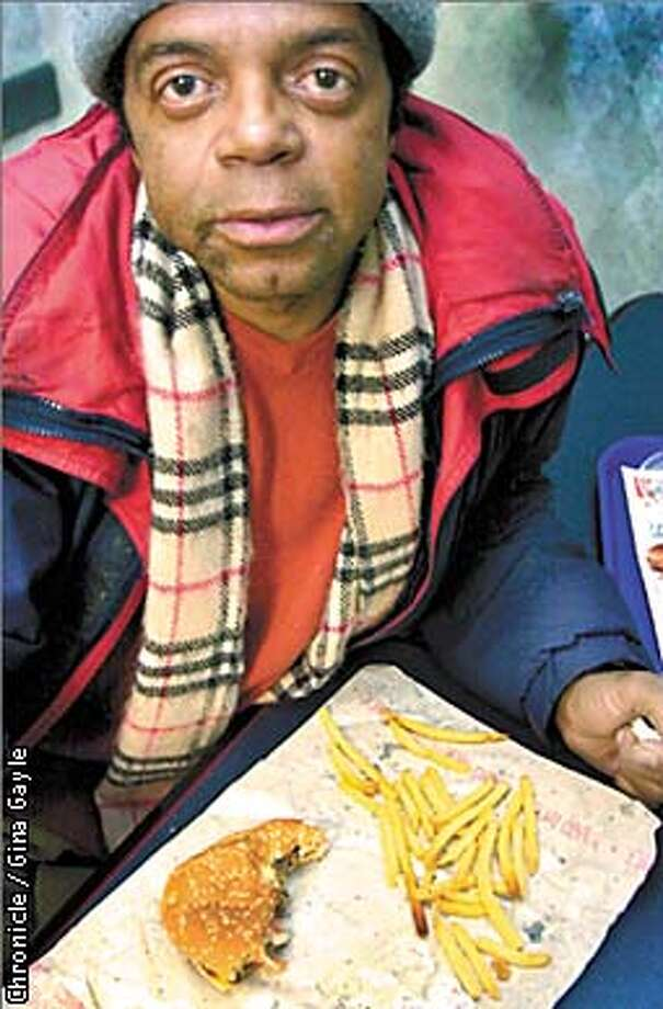 Gaylord Dixon, a homeless man talks and reflects about life on the streets as he was treated to an early Christmas dinner at Jack in the Box on Geary and Mason streets. Photo by Gina Gayle/The SF Chronicle. Photo: GINA GAYLE