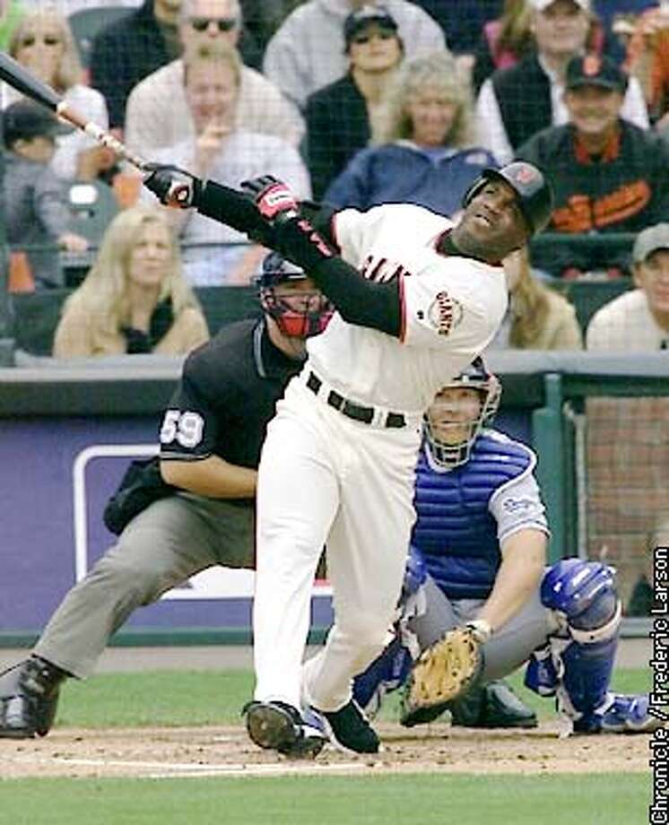 : Giants Barry Bonds hits his 73rd home run off Dodgers pitcher Dennis Springer at PacBell. Chronicle photo by Frederic Larson Photo: FREDERIC LARSON