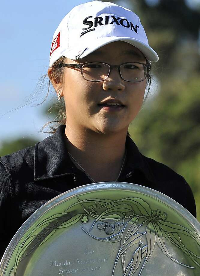 Thirteen-year-old Lydia Ko of New Zealand holds the leading amateur trophy after completion of the Women's Australian Open golf tournament in Melbourne on February 6, 2011. Taiwan's three-time major winner Yani Tseng won the event with a score of 16 under, seven strokes ahead of Ji Eun-Hee of South Korea, her compatriot Jiya Shin and Melissa Reid of England, who all finished in equal second place. IMAGE STRICTLY RESTRICTED TO EDITORIAL USE - STRICTLY NO COMMERCIAL USE AFP PHOTO / Paul CROCK (Photo credit should read PAUL CROCK/AFP/Getty Images) Thirteen-year-old Lydia Ko of New Zealand holds the leading amateur trophy after completion of the Women's Australian Open golf tournament in Melbourne on February 6, 2011. Taiwan's three-time major winner Yani Tseng won the event with a score of 16 under, seven strokes ahead of Ji Eun-Hee of South Korea, her compatriot Jiya Shin and Melissa Reid of England, who all finished in equal second place.     IMAGE STRICTLY RESTRICTED TO EDITORIAL USE - STRICTLY NO COMMERCIAL USE    AFP PHOTO / Paul CROCK (Photo credit should read PAUL CROCK/AFP/Getty Images) Photo: Paul Crock, AFF/Getty Images