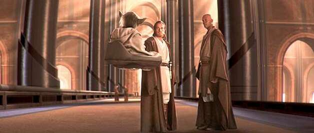 Jedi Master Yoda (played by Frank Oz), Obi-Wan Kenobi (Ewan McGregor) and Mace Windu (Samuel L. Jackson) in Star Wars: Episode II Attack of the Clones.  (HANDOUT PHOTO) Photo: HANDOUT