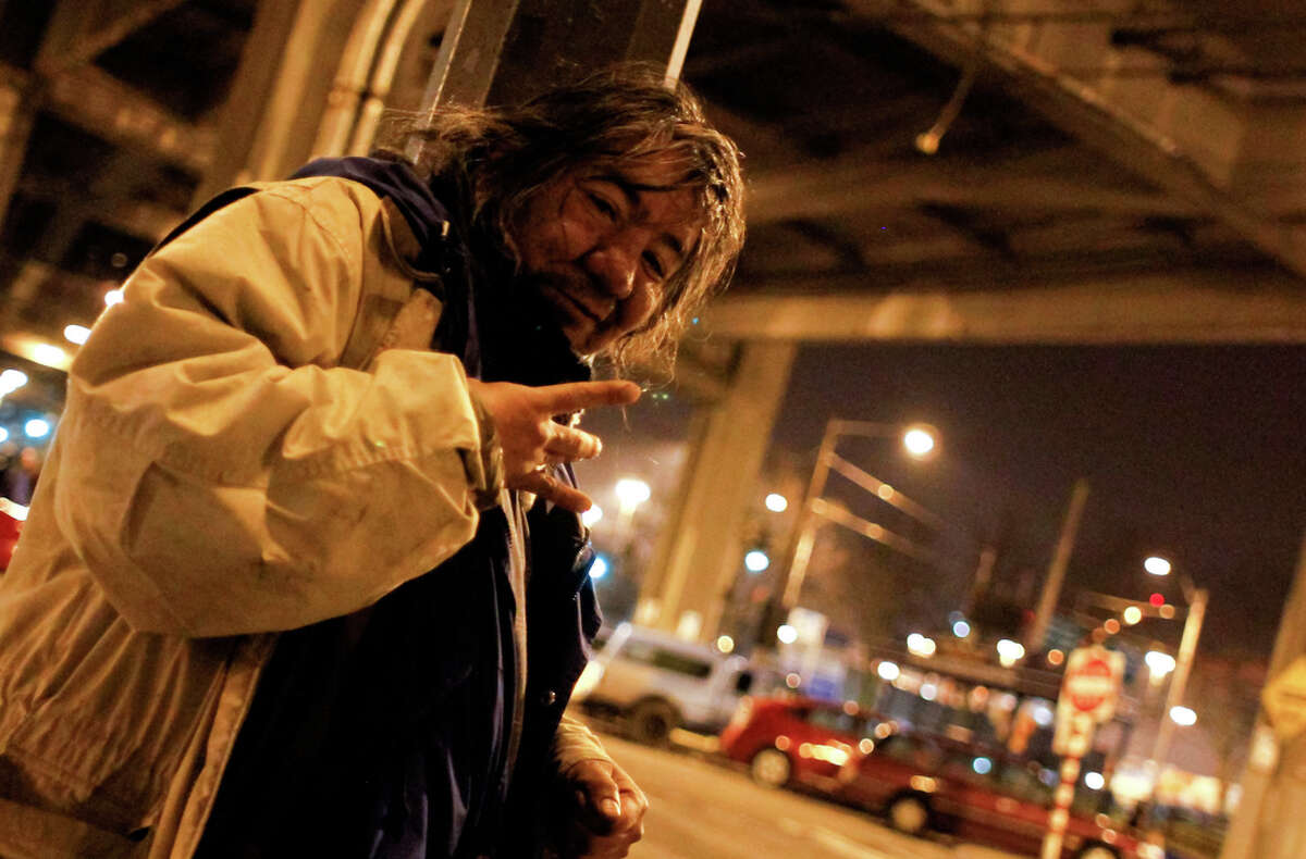 A homeless man poses near the Alaskan Way Viaduct in Seattle on Friday, Jan. 27, 2012. Local volunteers and organizations along with the Seattle/King County Coalition on Homelessness attempted to count all unsheltered homeless people throughout King County as part of the 32nd annual One Night Count on Friday Jan. 27, 2012. An estimated 800 volunteers thoroughly combed the streets of King County finding that 2,594 men, women and children had no shelter.