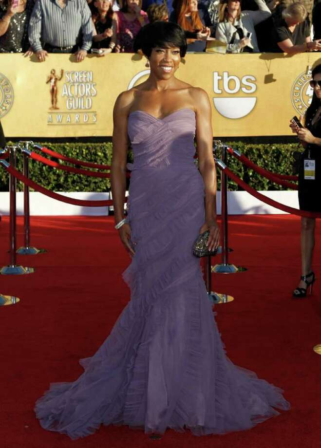 Regina King arrives on the red carpet at the 18th Annual Screen Actors Guild Awards on Sunday Jan. 29, 2012 in Los Angeles. (AP Photo/Matt Sayles) Photo: Matt Sayles, STF / AP