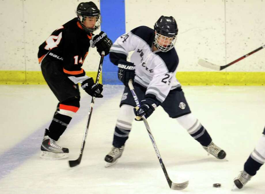 Staples' Jack Mendillo controls the puck against Stamford Jan. 4. Mendillo had an assist Saturday in a 7-6 home loss to Westhill. Photo: Autumn Driscoll, Autumn Driscoll/Staff Photographer / Connecticut Post