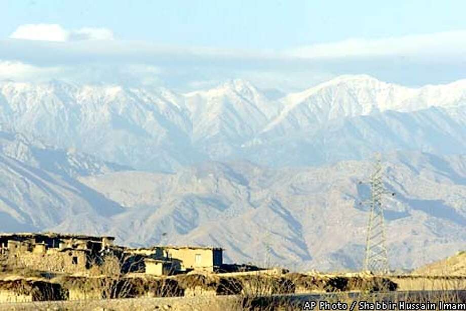 The Tora Bora mountains in Afghanistan are seen from the Pakistani village of Arawali, Saturday, Dec. 22, 2001. (AP Photo/Shabbir Hussain Imam) Photo: SHABBIR HUSSAIN IMAM