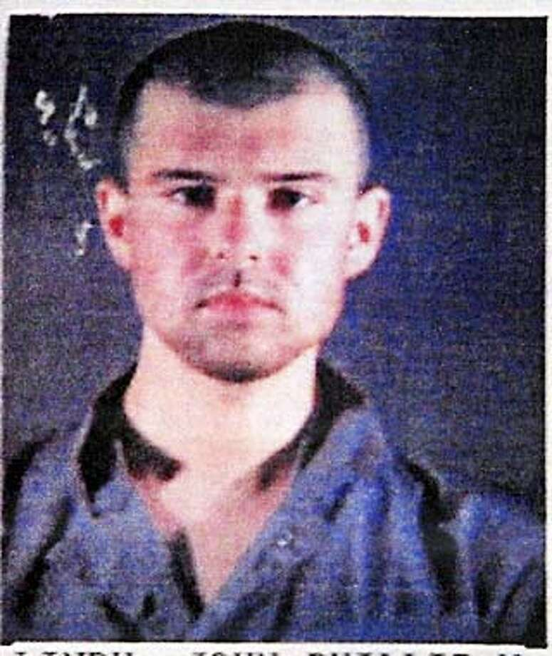 A federal judge on May 6, 2002 pushed for prosecutors to allow American Taliban John Walker Lindh's lawyers to interview by telephone or by video detainees captured in Afghanistan who are being held at a U.S. military base in Cuba. U.S. District Judge T.S. Ellis put off until late May a decision on interviews of potential key witnesses, Taliban and Al-Qaeda prisoners at the U.S. Naval Base at Guantanamo Bay who may have information helpful to Lindh's defense at trial. Walker Lindh is shown in this undated police booking photo. REUTERS/Files Photo: HO