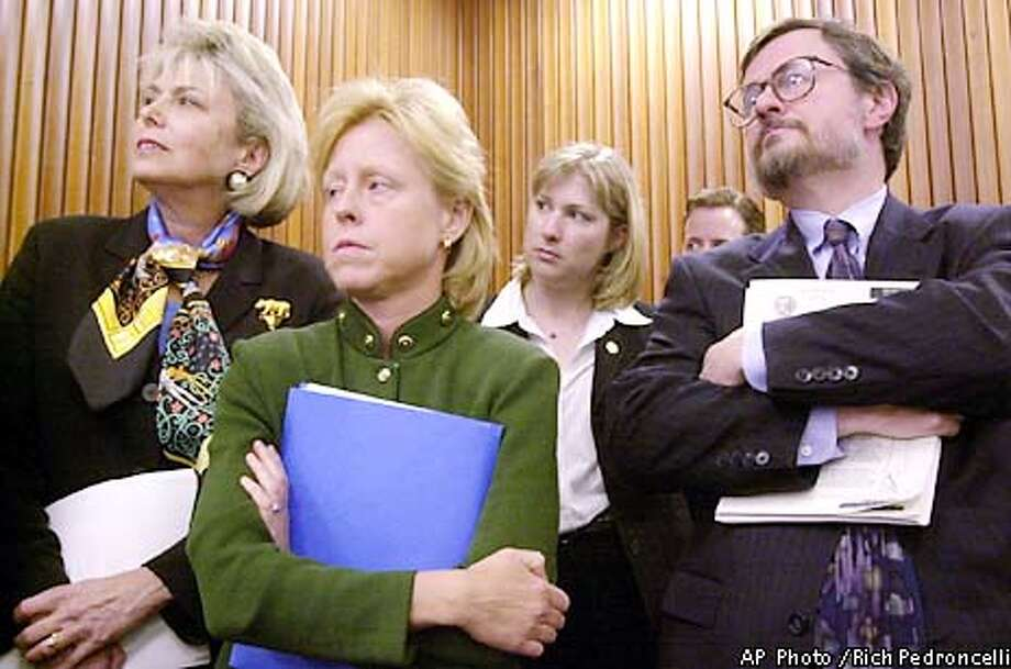 Staff members of California Gov. Gray Davis, from left, chief of staff Lynn Schenk, policy advisor Susan Kennedy, deputy press secretary Hilary McLean and finance director Tim Gage, right, listen as Davis unveils his revised 2002-2003 during a Capitol news conference in Sacramento, Calif., Tuesday, May 14, 2002. Davis plans to fill an estimated $23.6 billion budget shortfall with deep spending cuts and some tax increases. (AP Photo/Rich Pedroncelli) Photo: RICH PEDRONCELLI