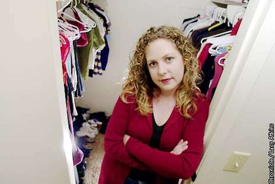 Alison Hultman, 21 years old, at her apartment , in San Diego, in her closet with clothes that she charged and got into credit card debit.  Photo By Lacy Atkins/SanFrancisco Chronicle Photo: Lacy Atkins