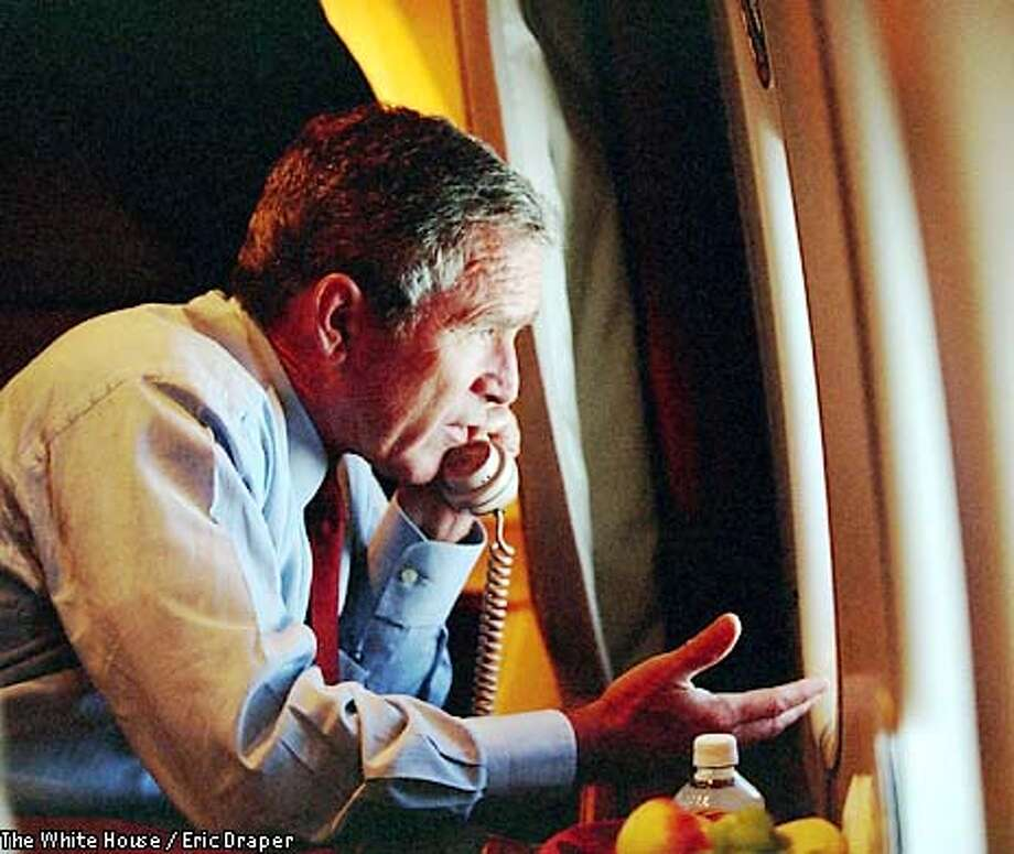 President Bush speaks to Vice President Dick Cheney by phone aboard Air Force One after departing Offutt Air Force Base in Nebraska, Tuesday, Sept. 11, 2001. (AP Photo/The White House, Eric Draper, HO) Photo: ERIC DRAPER